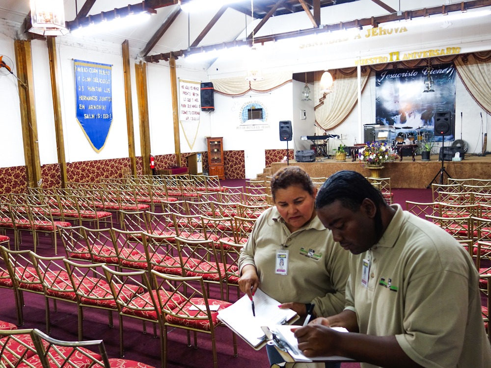 SCOPE members, Maria Dubon and Landry Thomas review what kind of environmentally friendly improvements can be made at a South LA Church.
