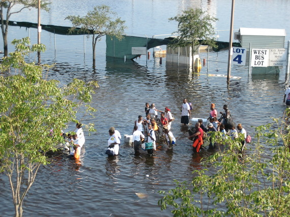 Hurricane Katrina survivors wade through water on the street on Aug. 31, 2005, two days after the storm made land fall. Photo Credit: News Muse, flickr